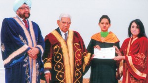 Chief Guest Sh. Gopal Krishan Chatrath, Ex. Advocate General, Ex. MLA, Fellow, Syndic & Dean, Faculty of Law, PU, Chd. along with the College President & Principal conferring degree on a proud Graduate at Convocation-2014