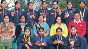 Appreciative athletes of GNGC who bagged Third position in PU Athletic Championship (and Overall Championship in Ludhiana Distt. Women Sports Festival) displaying their medals in a click with College Principal and their Mentors