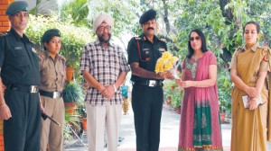 Commanding Officer Col. Ashwani Kumar, 3 Pb. Girls Bn. NCC being welcomed by the College Principal and College President to address the students on 'Aims and Objectives of NCC