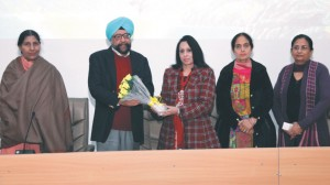 Revered College Principal Dr. (Mrs.) Charanjit Mahal presenting a bouquet to the College President S. Gurbir Singh on a get-together