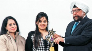 College President S. Gurbir Singh and College Principal Dr. (Mrs.) Charanjit Mahal presenting a token of appreciation to an exemplary student at Alumni Meet-2013