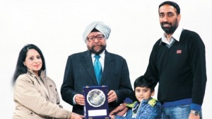 College President being felicitated by the College Principal alongwith S. Ishwarjot Singh Cheema, Trustee, GNET and Master Ryan at Alumni Meet-2013