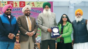 College President & Principal presenting a token of remembrance to S. Ajmer Singh Lakhowal, Chairman, Punjab Mandi Board at the closing ceremony of Annual Athletic Meet-2015 in the presence of Prof. (Dr.) S.S. Mahal & S. Ishwarjot Singh Cheema - Trustees, GNET