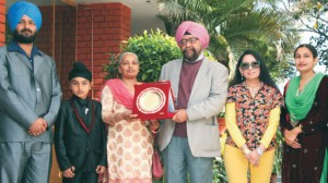 College President S. Gurbir Singh and College Principal Dr. (Mrs.) Charanjit Mahal honouring Mrs. Harjinder Kaur, Senior Clerk on her superannuation in the presence of her family members