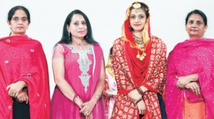 The winner of 'Miss Punjaban' contest sharing a click with Hon'ble Principal Dr. (Mrs.) Charanjit Mahal on Teej Festival alongwith the incharges