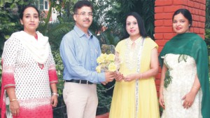 An Awakening Address: extending a floral welcome to Dr. Amit Dhiman, Head, Department of Oncology, DMC&H, Ludhiana on his visit for an extension lecture Principal Dr. (Mrs.) Charanjit Mahal